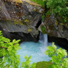 Listen to the water splashing from a small waterfall as water pours gently over rocks in a stream.