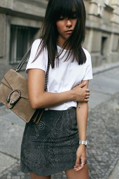 Nisi is wearing: Gucci Dionysus bag, Hermès Oran Sandals, studded suede skirt and a basic white t-shirt from Acne Studios - teetharejade.com
