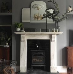 The House at The Junction | Victorian marble fireplace with log burner