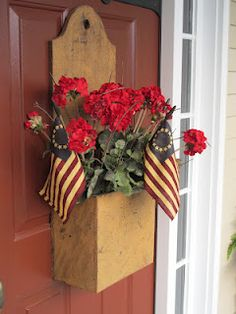 Prim Mustard Yellow Door Box...with red geraniums & flags.