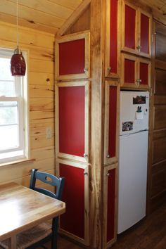 Nice way to hide clutter and add color in a tiny house kitchen