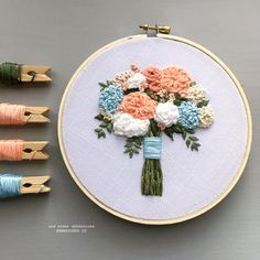 floral embroidery Inspired by the colors and flowers of summer, this one of a kind embroidery hoop art features embroidered peach, white, and ecru florals, pale blue hydrangea Floral Embroidery Patterns, Hand Work Embroidery, Hand Embroidery Stitches, Modern Embroidery, Embroidery Hoop Art, Hand Embroidery Designs, Embroidery Techniques, Cross Stitch Embroidery, Embroidery Sampler