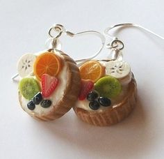 Five Fruit Tart  Earrings on Etsy, she also makes knitting stitch markers but could easily turn them into crochet ones. All of her products look good enough to eat!