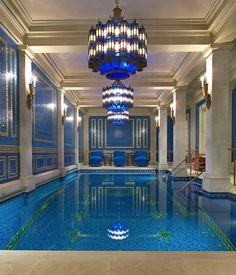 Beautiful blue wall and pool tiles complement the limestone columns and moldings.