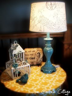 DIY French Script Lamp Shade-- a plain shade from Target, print-outs from the internet, and an ultrafine tip Sharpie