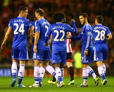 Eden Hazard Photos - Eden Hazard of Chelsea is congratulated by team mate Willian after scoring his goal during the Barclays Premier League match between Sunderland and Chelsea at Stadium of Light on December 4, 2013 in Sunderland, England. - Sunderland v Chelsea