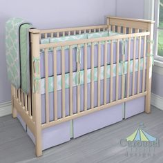 Crib bedding in Mint Large Quatrefoil, Solid Lavender, Solid Mint Minky, Mint Zippy Chevron, Solid Icey Mint. Created using the Nursery Designer® by Carousel Designs where you mix and match from hundreds of fabrics to create your own unique baby bedding. #carouseldesigns