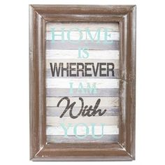 The most important thing about your home is who you share it with. This Home Is Wherever I Am With You Faux Wood Sign reminds your loved ones that they're the most meaningful part of your life! Featuring a ridged brown frame, a faux wood striped background, and turquoise and black text, this lovely MDF sign is the perfect addition to your bedroom, living room or entryway.