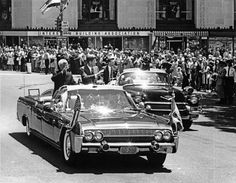 June 4, 1963 President John F. Kennedy and President of India, Dr. Sarvepalli Radhakrishnan, wave to crowds from the presidential limousine (Lincoln-Mercury Continental convertible) during a parade in honor of President Radhakrishnan.  Washington, D.C. - John F. Kennedy Presidential Library & Museum