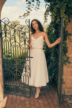 This effortless midi skirt is the perfect pick for a playful bridal ensemble. Catherine Deane, Bhldn, Bridal Outfits, Headgear, Body Measurements, Garden Wedding, Midi Skirt, Strapless Dress, Gowns