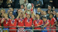 Arjen Robben lifts the European Cup after coring a last minute winner for Bayern.