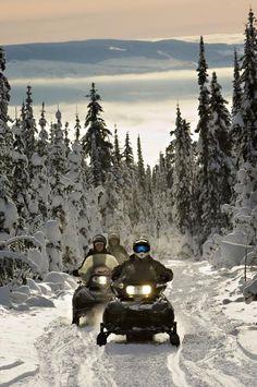 Snowmobiling at Sun Peaks Resort, Canada.