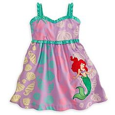 Disney Ariel Woven Dress for Girls | Disney StoreAriel Woven Dress for Girls - She'll make waves in this all-cotton dress featuring the Little Mermaid floating in an ocean of shells. Green and red rhinestuds accent the tail and hair on this Ariel Woven Dress that will sparkle happily ever after.