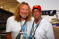 Rock legends Robert Plant (L) of Led Zeppelin and Eric Clapton (R) of Cream are seen on the grid before the Bahrain Formula One Grand Prix at the Bahrain International Circuit on April 26, 2009 in Sakhir, Bahrain.