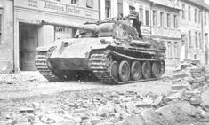 A Panther Ausf G moving through a battle damaged city
