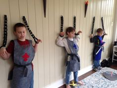 Boys' medeival knight birthday party decorations--dungeon with paper torches and paper chains
