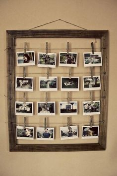 Cute rustic picture display idea...clothes pins, twine, wooden frame. I might want to modernize this a bit, but love the idea. You can switch out photos whenever, or juxtapose them with other things.