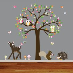 These playful Little Forest wall decals will bring a very cute scene to your wall. A beautiful colorful patterned woodland tree along with darling