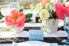 Cielo farms vintage summer outdoor wedding white table linen with pink and yellow flower centerpiece decor with brown wood chairs and black and white place settings