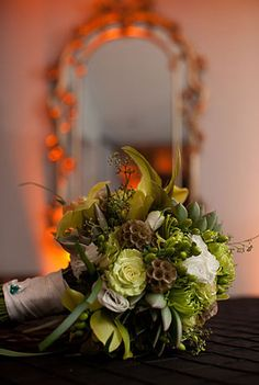 Green, yellow, and brown bouquet featuring roses, scabiosa, lisianthus, chrysanthemums, and succulents.