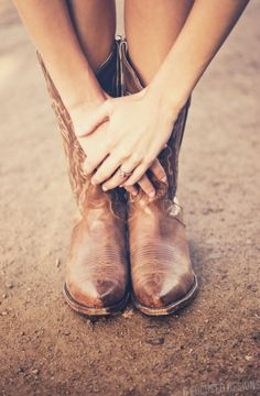 Engagement Pictures  her boot next to his boot her hand on his hand! =]