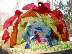 Tissue paper rainbow sun catcher craft.