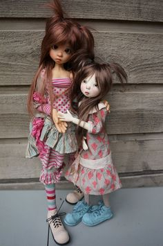 Tall Kaye Wiggs doll with another I don't recognize