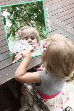 Painting on mirrors with shaving cream: easy fun that toddlers and preschoolers can enjoy together! #sensory