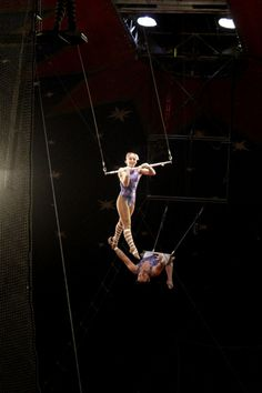 Trapeze artists flying through the air at a performance in Monticello, Utah on May 12th, 2012.