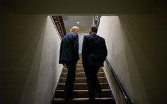 President Barack Obama and Vice President Joe Biden talk as they walk up a staircase in the West Wing of the White House on April 3.