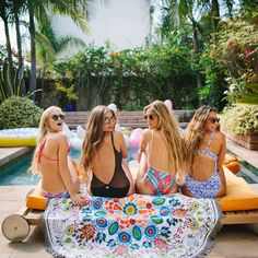 Wildflower round towel with four girls at the pool