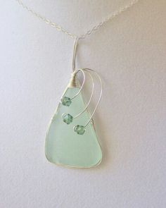 sea glass necklace, sea glass jewelry, Sterling Silver Necklace, Sea Glass Necklace, Drilled Sea Glass, Wire Wrapped Sea Glass Jewelry door NauticalSeaGlass op Etsy https://www.etsy.com/nl/listing/102715338/sea-glass-necklace-sea-glass-jewelry