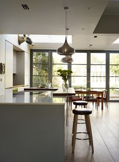 Roundhouse Urbo kitchen in extension with wooden version of crittall doors