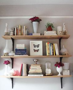 beautiful wooden shelves and assorted vases
