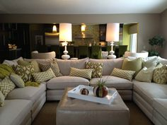 Family Room Sectional, White sofa, White accessories, white lamps, leather ottoman, Sam Moore sectional
