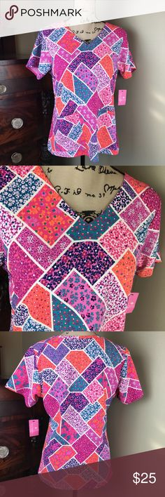 NWT Vera Bradley Scrub Top. Size S NWT Floral collage print, V neckline, 2 front pockets and inner pocket with ID loop.  Short sleeve. A breast cancer awareness item.  Vera Bradley Scrub Top Size S  See my other scrub tops and sets listings with brands from Carhartt, Vera Bradley, Wonderwink, Wonderflex, Wonderwork, Zoe + Chloe, Urbane Scrubs, Heart Soul, Med Couture, Medline, and Standard Textiles.    VM3 Vera Bradley Other