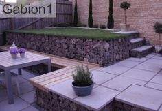 Terraced gabion retaining walls of different sizes were used to build this pation and seating area. http://www.gabion1.co.uk
