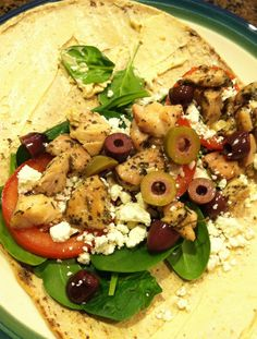 Greek Wrap. AMAZING :)    1 Whole Wheat Flatout Flatbread  1 Sun-dried Tomato Laughing Cow     Cheese  --Spinach  --Feta  --Tomato --olives --Cook chicken with lemon, garlic, basil--chop up and add to wrap.    BEST WRAP WE'VE EVER MADE :) Enjoy!