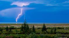 Lightning across Hudson Bay shores. (photo: Didrik Johnck) #travel #canada