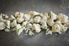 Raw cauliflower is a delicious and healthy low calorie snack. I usually eat it just as a snack but it is also great in salads :)  Ingredients 1 cauliflower Sea salt Freshly ground pepper ½ tablespoon of your best olive oil  Divide the cauliflower in bite sized pieces. Add all of the ingredients in a bowl and mix together. Serve immediately or store