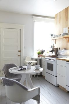 gray painted wood floor.  eclectic kitchen by Jenn Hannotte / Hannotte Interiors.