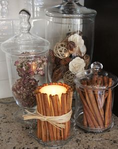 I love this idea! When the candle warms the cinnamon, the house fills with the great scent of fall spice!