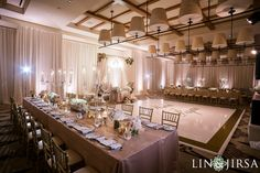 An elegant wedding at Terranea Resort filled with tradition and decorated with an abundance of food and florals and soft blush lighting. Photo by Lin & Jirsa. Lighting by Elevated Pulse. #weddinginspiration #ballroomwedding #weddinglighting #blushwedding #persianwedding #weddingideas #brides #receptiondecor