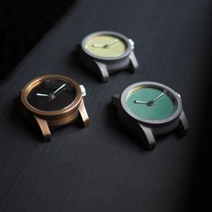 Schofield british made watches, the Beater Bare Bones. Titanium with a green dial, steel with a Sussex mud dial, and bronze with a black dial. #britishwatchcompanies #schofield #englishwatchbrands #watchesmadeintheUK #luxuryBritishwatches #luxurywatchstraps