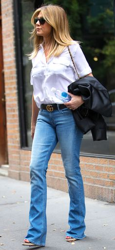 Jennifer Aniston in a white button-down shirt, bootcut jeans and a Gucci belt - click through for more celebrity fall outfit ideas!