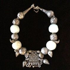 Necklace of 16th century glass moonstone beads, 19th c. Yemeni, and Turkoman silver beads.