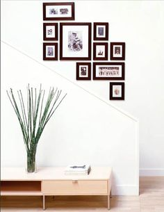 picture frame arrangement going up the stairs