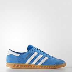 The original Hamburg came on the scene in the early '80s as part of adidas' famous City Series. This updated version of the popular shoes features a plush suede upper with overlaid 3-Stripes and a distinctive gum rubber outsole. The gold foil logo on the upper gives a flash finish to this icon.