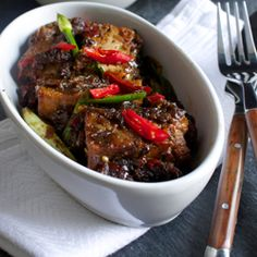 Crispy tofu in a fiery peppery sweet soy and caramelised onion sauce