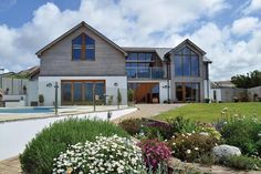 Lesley Richardson overcame three years of planning battles to build the house of her dreams in a stunning country location: http://www.self-build.co.uk/timber-frame-home-stunning-views